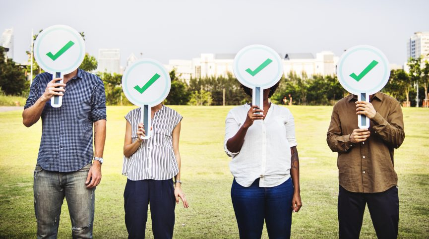 Diverse friends holding checkmark icons